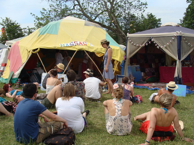 The main fundraising activity, however, is the performance of holistic healing therapies, which has crowds gathering outside the tent.